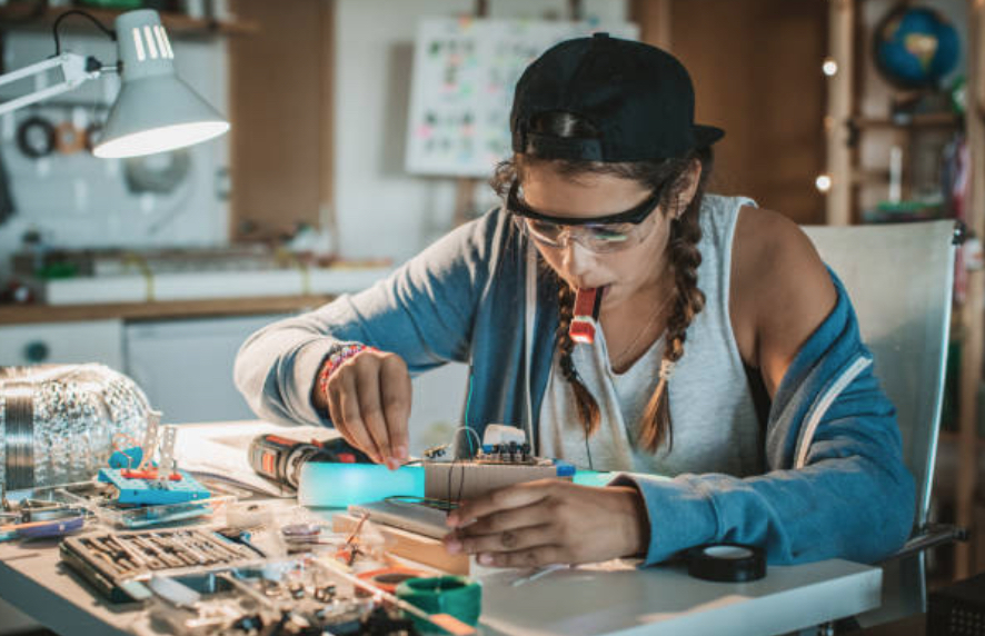 a young student working with circuit boards