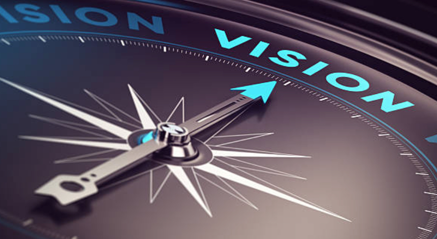 a compass pointing towards vision