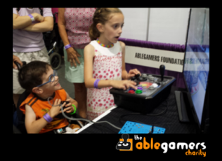 Image of two kids playing an accessible video game. The AbleGamers Charity.