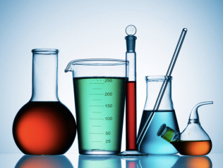 science beakers and flask filled with colored liquids