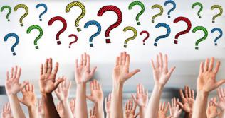 a bunch of hands raising questions